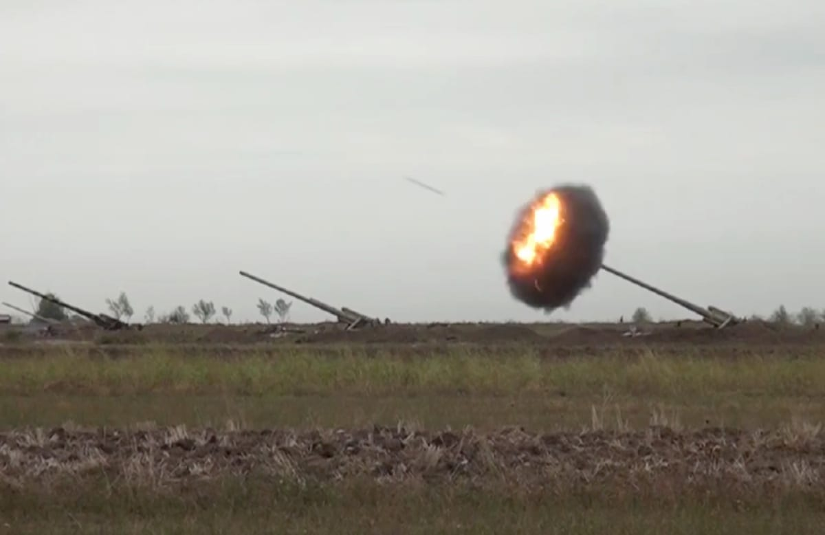 """BAKU, AZERBAIJAN - SEPTEMBER 28: (----EDITORIAL USE ONLY – MANDATORY CREDIT - """"AZERBAIJAN MINISTRY OF DEFENCE / HANDOUT"""" - NO MARKETING NO ADVERTISING CAMPAIGNS - DISTRIBUTED AS A SERVICE TO CLIENTS----) The image shared by Azerbaijan Defence Ministry shows howitzers firing munitions towards Armenian positions after the launch of a counter then a forward operation on September 28, 2020. Azerbaijani forces took control of some highlands around the Talis Village. ( AZE Defence Ministry - Anadolu Agency )"""
