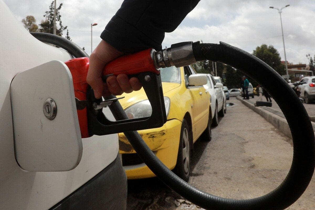 A driver fills his car with gasoline at a petrol station in the Syrian capital Damascus on 16 April 2019 [LOUAI BESHARA/AFP/Getty Images]