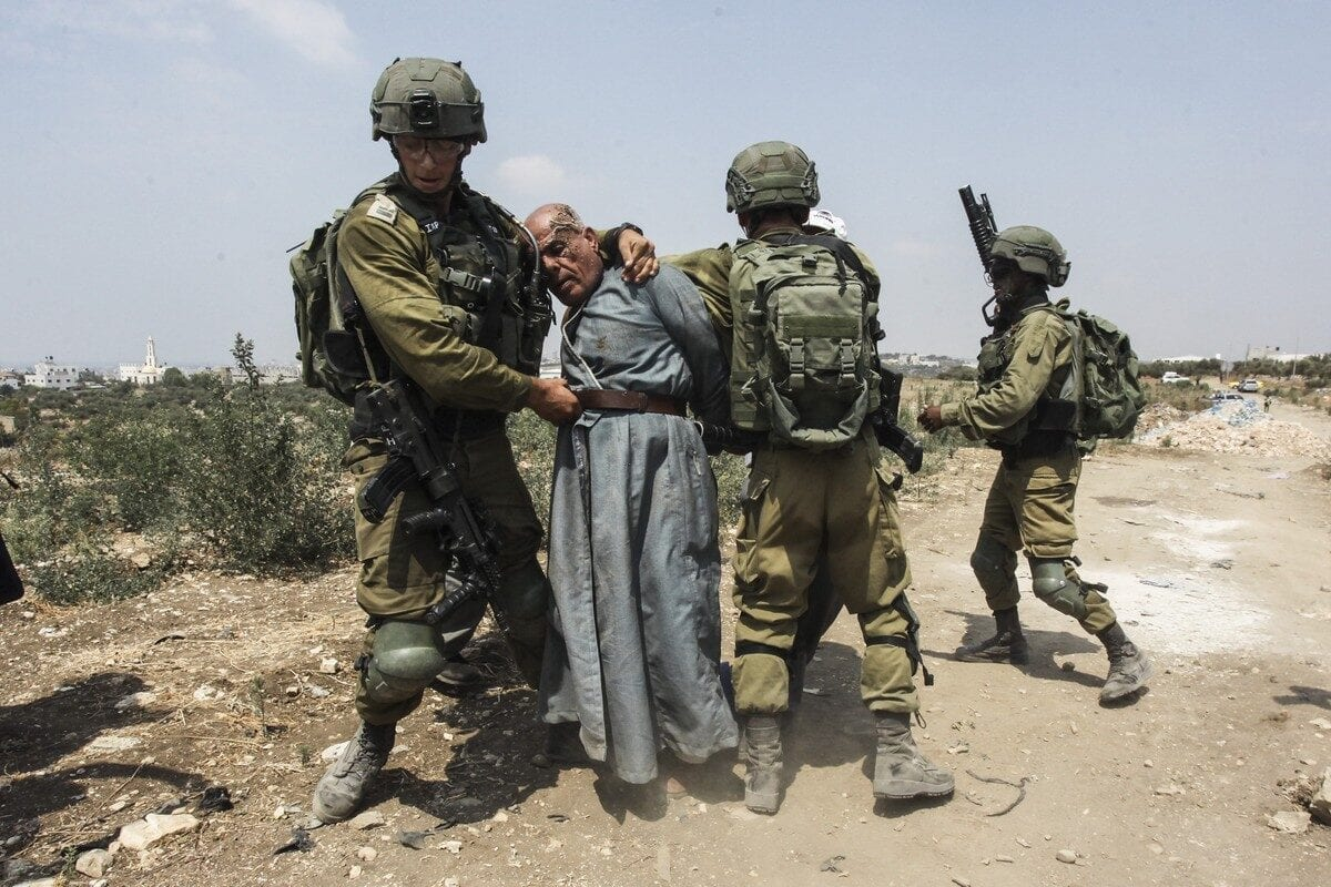 Israeli forces detain 64 year old Palestinian Hayri Khanoun during a protest against the planned illegal Israeli settlement in the region, in Shufa village of Tulkarm city, West Bank on September 01, 2020 [Nedal Eshtayah / Anadolu Agency]