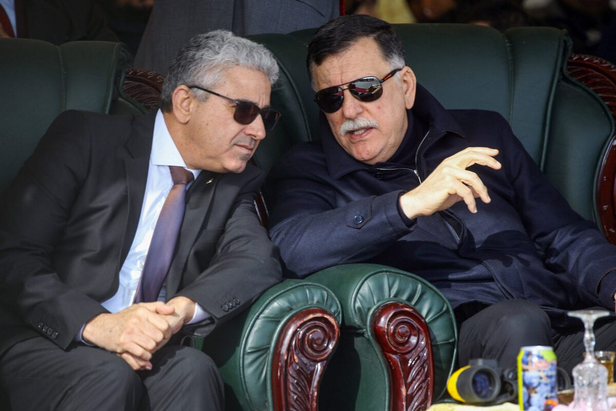 Libya's GNA Prime Minister Fayez al-Sarraj (R) speaks with Interior Minister Fathi Bashagha (L) during a graduation ceremony for a new coastguard cadets in the port of Tripoli on January 3, 2019 [MAHMUD TURKIA/AFP via Getty Images]