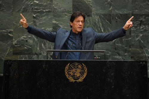 "Pakistani Prime Minister Imran Khan speaks during the 74th Session of the General Assembly at UN Headquarters in New York on September 27, 2019. - India is planning a ""bloodbath"" in Kashmir, Khan told the UNGeneral Assembly. The Indian-controlled part of the disputed territory has been under lockdown since New Delhi scrapped its semi-autonomous status in early August, and Khan said armed forces there would turn on the population after the curfew was lifted. ""There are 900,000 troops there, they haven't come to, as Narendra Modi says -- for the prosperity of Kashmir... These 900,000 troops, what are they going to do? When they come out? There will be a bloodbath,"" he said. (Photo by TIMOTHY A. CLARY / AFP) (Photo credit should read TIMOTHY A. CLARY/AFP via Getty Images)"