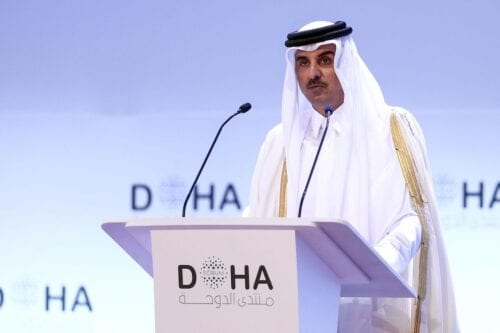 Emir of Qatar Sheikh Tamim bin Hamad al-Thani delivers a speech during the opening session of the Doha Forum in the Qatari capital on 14 December 2019. [MUSTAFA ABUMUNES/AFP via Getty Images]
