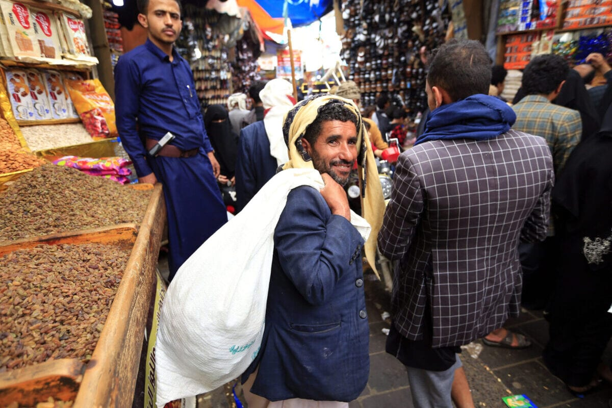 Yemenis buy sweets and nuts at a market in the capital Sanaa on July 27, 2020, as Muslims prepare to celebrate the annual holiday of Eid al-Adha, or the Festival of Sacrifice [MOHAMMED HUWAIS/AFP via Getty Images]