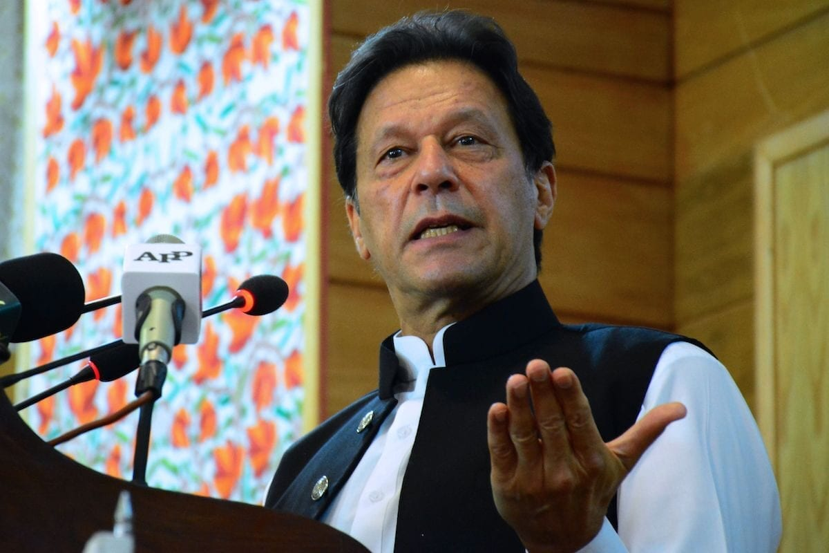 Pakistan's Prime Minister Imran Khan addresses the legislative assembly in Muzaffarabad, the capital of Pakistan-controlled Kashmir on 5 August 2020, to mark the one-year anniversary after New Delhi imposed direct rule on Indian-administered Kashmir. [AFP via Getty Images]