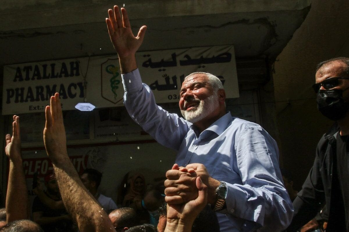 Hamas' political bureau chief Ismail Haniyeh greets supporters during a visit to the Ain el-Helweh camp, Lebanon's largest Palestinian refugee camp, near the southern coastal city of Sidon on 6 September 2020. [MAHMOUD ZAYYAT/AFP via Getty Images]