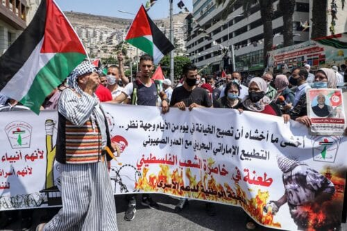 Demonstrators protest against the United Arab Emirates' and Bahrain's decisions to normalise relations with Israel, in the city of Nablus in the occupied West Bank on 15 September 2020. [JAAFAR ASHTIYEH/AFP via Getty Images]