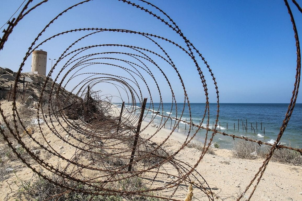 A view of a barbed wire fence along the maritime border between the Palestinian Gaza Strip and Egypt in Rafah on 27 September 2020 [SAID KHATIB/AFP via Getty Images]