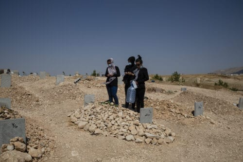 Family members visit the grave of their father at the dedicated coronavirus cemetery on September 04, 2020 in Sulaymaniyah, Iraq [Hawre Khalid/Getty Images]