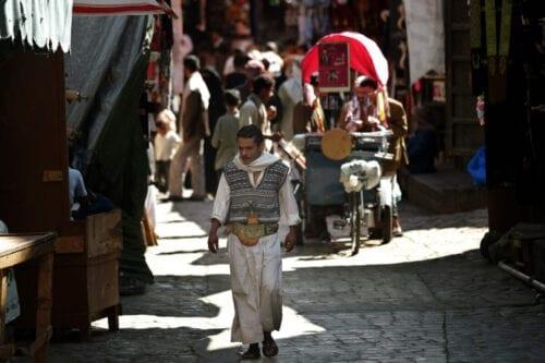 A Yemeni man walks in the old city of Sanaa on November 8, 2009 [MARWAN NAAMANI/AFP via Getty Images]