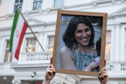 Supporters hold a photo of Nazanin Zaghari-Ratcliffe during a vigil for British-Iranian mother imprisoned in Tehran outisde the Iranian Embassy on January 16, 2017 in London, England [Chris J Ratcliffe/Getty Images]