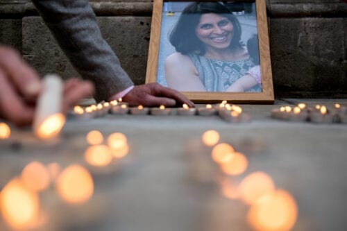 A photo of Nazanin Zaghari-Ratcliffe is seen amongst candles during a fourth birthday vigil for her daughter Gabriella opposite the Foreign & Commonwealth Office, King Charles Street, London, SW1A on June 11, 2018 in London, England. [Chris J Ratcliffe/Getty Images]