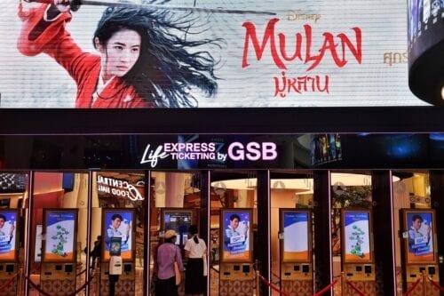 People buy tickets for Disneys Mulan film at a cinema in Bangkok on 8 September 2020 [LILLIAN SUWANRUMPHA/AFP/Getty Images]