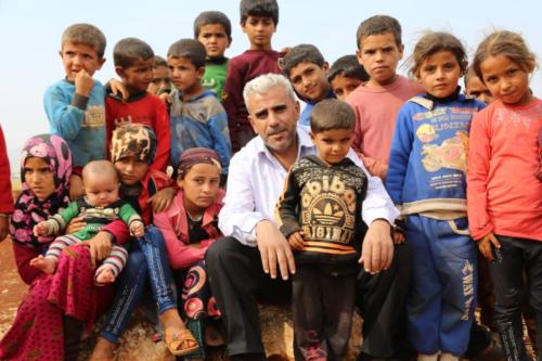 Dergham Hammadi visiting a refugee camp in Syria