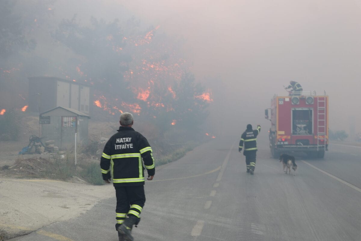Firefighters are seen after a fire broke out at a forested land in Belen district and spread to Arsuz and Iskenderun district of Hatay, Turkey on 9 October 2020. [Salim Taş - Anadolu Agency]