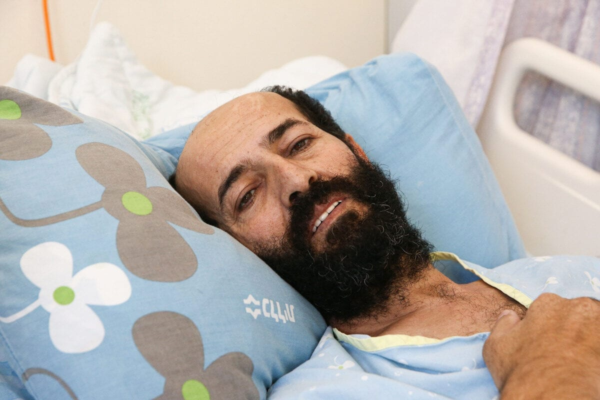 Palestinian prisoner in Israeli jail Maher Al-Akhras, who is in a hunger strike for 85 days, speaks to media, receiving medical treatment at hospital in Rehovot, Israel on October 14, 2020 [Mostafa Alkharouf/Anadolu Agency]