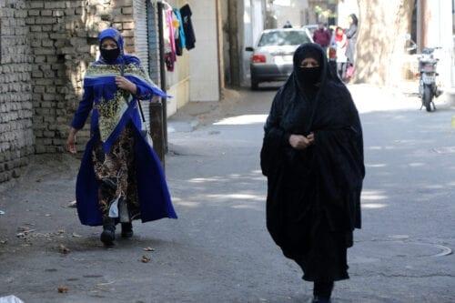 People wearing face masks as a precaution against coronavirus, walk through the street in southeastern Ni'Matabad village of Tehran, Iran on October 15, 2020 [Fatemeh Bahrami / Anadolu Agency]