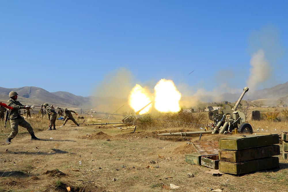 Azerbaijan army firing munitions towards Armenian positions during on 20 October2020 [Azerbaijani Defense Ministry/Anadolu Agency]