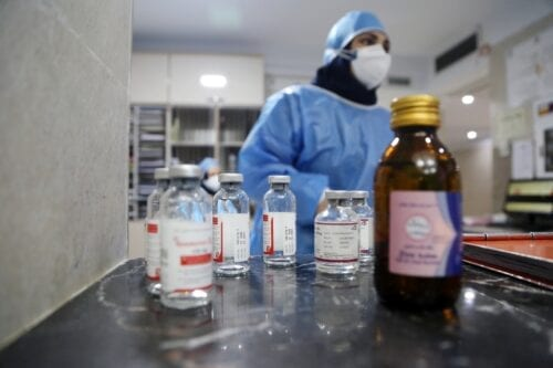 TEHRAN, IRAN - OCTOBER 20: A female medical worker, wearing protective gear, is seen behind medicine bottles in a room with coronavirus (COVID-19) patients at Rasoul Akram Hospital after sudden hike in COVID-19 cases led hospitals to reach full capacity in Tehran, Iran on October 20, 2020.A ( Fatemeh Bahrami - Anadolu Agency )