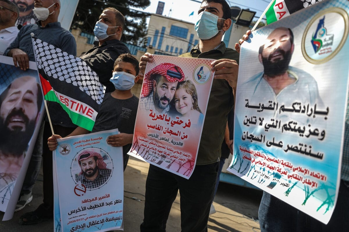 People gather in Gaza to support Maher Al-Akhras, a Palestinian detainee on hunger strike on 23 October 2020 [Ali Jadallah/Anadolu Agency]