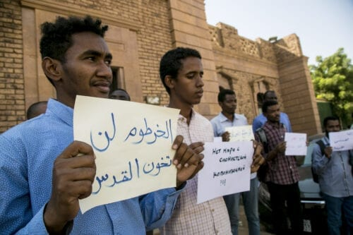 Demonstrators, mostly university students, gather in front of Faculty of Medicine of University of Khartoum during a protest against government's decision to resume diplomatic and commercial relations with Israel, in Khartoum, Sudan on 26 October 2020. [Mahmoud Hjaj - Anadolu Agency]