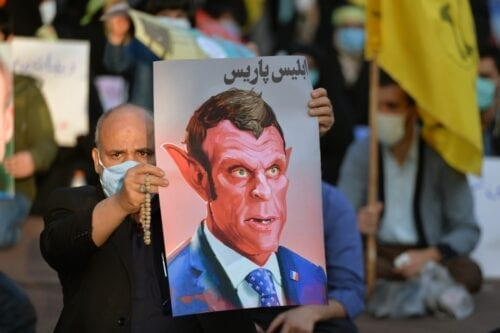 TEHRAN, IRAN - OCTOBER 28: Demonstrators gather in front of Embassy of France in Tehran during a protest against the publication of cartoons of Prophet Muhammad in France and against President of France Emmanuel Macron over his anti-Islam remarks, on October 28, 2020 in Tehran, Iran. ( Fatemeh Bahrami - Anadolu Agency )