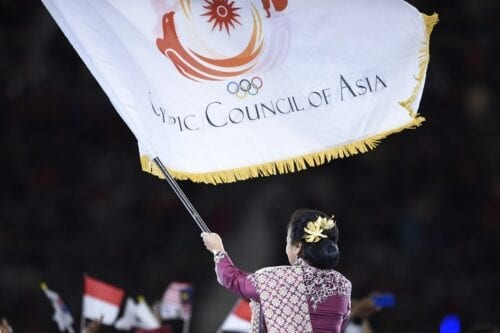 The flag of the Olympic Council of Asia (OCA) during the closing ceremony of the 2014 Asian Games in Incheon on 4 October 2014 [MARTIN BUREAU/AFP/Getty Images]