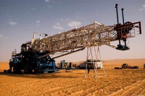 EL-SHARARA, LIBYA - JUNE 5: A Chinese oil drilling team working for Repsol, begins the task of assembling a massive drilling rig in the middle of the desert on June 5, 2004 in El-Sharara, Libya. With the lifting of US sanctions earlier this year, American oil companies, eager to find other avenues for oil exploration have begun negotiating with the Libyan government to return to its vast oil fields. (Photo by Benjamin Lowy/Getty Images)