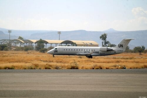 """This picture taken on February 3, 2020 shows a view of a United Nations Bombardier CRJ-200LR aircraft at Sanaa International Airport outside the Yemeni capital, that is meant to transport Yemeni child patients for a medical evacuation bound for the Jordanian capital amman. - Yemeni children in critical need of medical care were evacuated on February 3 from the rebel-held capital Sanaa, in what the United Nations hopes will be the first of many """"mercy flights"""". Seven young patients and their relatives flew out of Sanaa airport, which a Saudi-led coalition supporting the embattled Yemeni government has kept closed to commercial flights since 2016. The UN-marked plane later landed in the Jordanian capital Amman, where passengers were placed in buses which immediately ferried them to hospitals, an AFP photographer said. (Photo by MOHAMMED HUWAIS / AFP) (Photo by MOHAMMED HUWAIS/AFP via Getty Images)"""