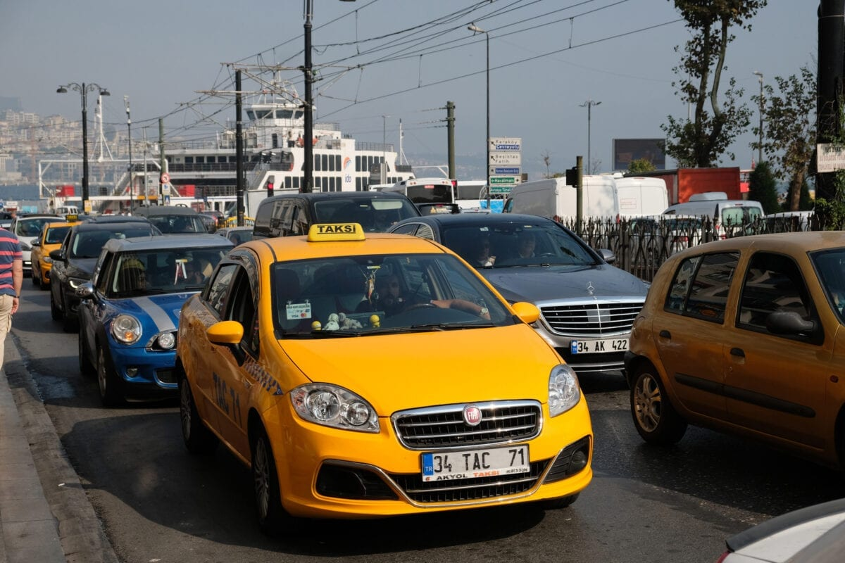 ISTANBUL, TURKEY - OCTOBER 19, 2019: A congested traffic scene with a yellow taxi on the front and a passenger ferry seen at the harbour on the European part of the city on October 19, 2019 in Istanbul, Turkey. (Photo by Kaveh Kazemi/Getty Images)