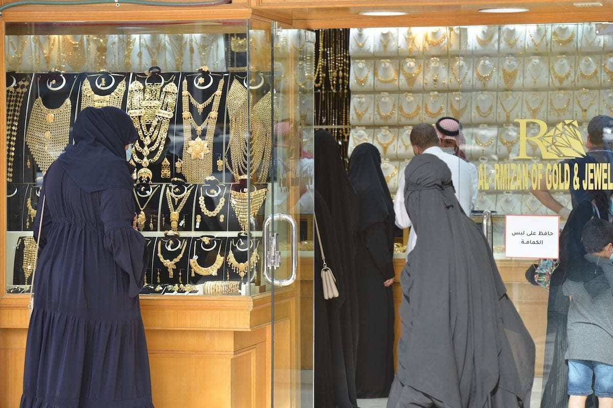 Saudis shop at a jewellery shop in the Taiba gold market in the capital Riyadh on 29 June 2020 [FAYEZ NURELDINE/AFP via Getty Images]
