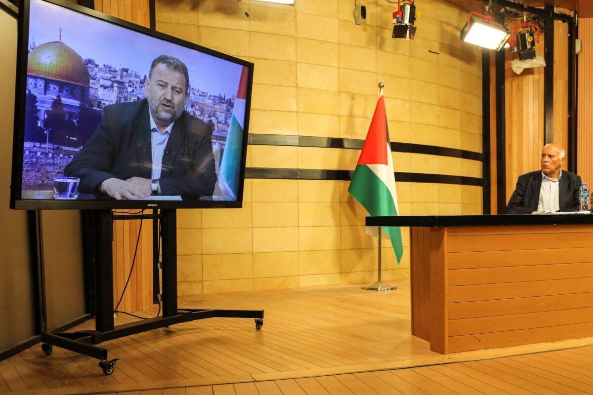 Senior Fatah official Jibril Rajoub, in the West Bank city of Ramallah, attends by video conference a meeting with deputy Hamas chief Saleh Arouri (on screen from Beirut) discussing Israel's plan to annex parts of the Israeli-occupied West Bank, on July 2, 2020 [ABBAS MOMANI/AFP via Getty Images]