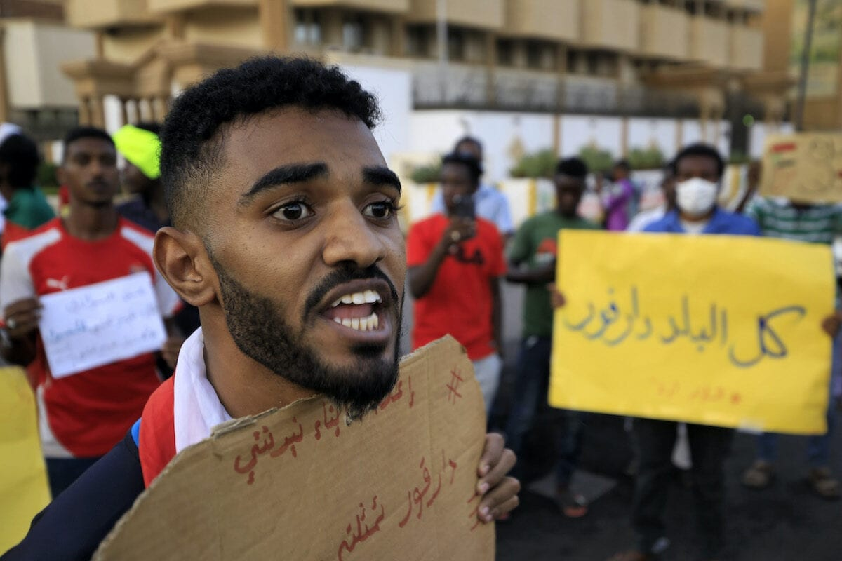A demonstrator chants slogans during a protest outside the Sudanese Professionals Association in the Garden City district of Sudan's capital Khartoum on 4 July 2020, in solidarity with the people of the Nertiti region of Central Darfur province in the country's southwest. [ASHRAF SHAZLY/AFP via Getty Images]