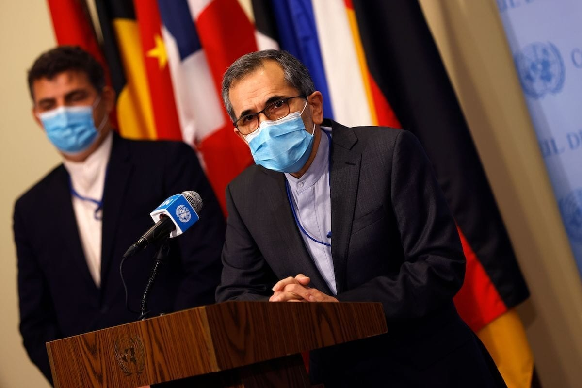 Iran's UN Ambassador Majid Takht Ravanch speaks to reporters after the US Secretary of State urged members of the UN Security Council to restore sanctions against Iran following meetings at UN headquarters in New York, on 20 August 2020. [MIKE SEGAR/POOL/AFP via Getty Images]