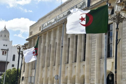Algerian flags flutter in front of the People's National Assembly (parliament) building in the capital Algiers, on 10 September 2020. [RYAD KRAMDI/AFP via Getty Images]