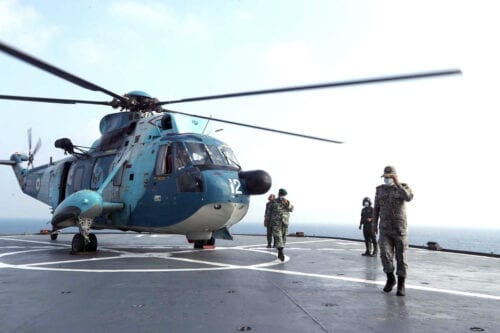 An Iranian army helicopter lands on a navy warship during the last day of a military exercise in the Gulf, near the strategic strait of Hormuz in southern Iran. on 12 September 2020 [Iranian Army office/AFP via Getty Images]