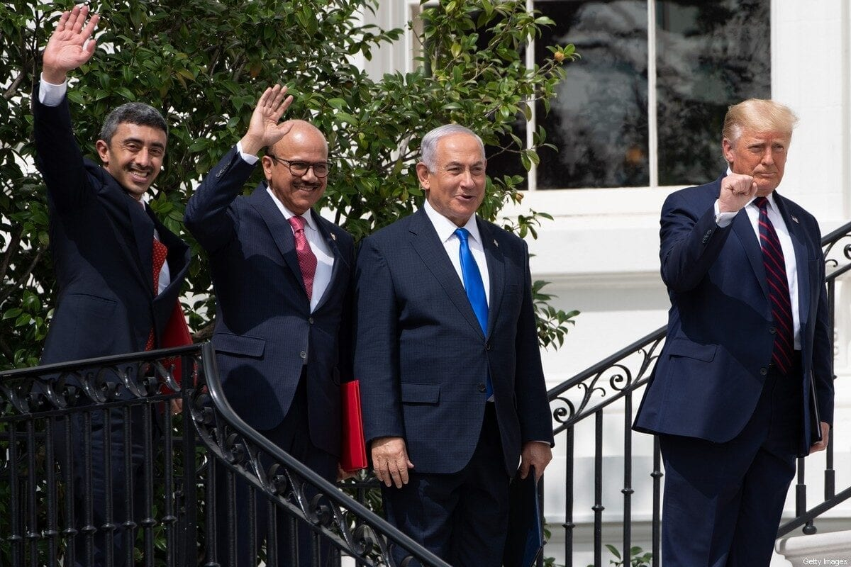 (L-R)UAE Foreign Minister Abdullah bin Zayed Al-Nahyan, Bahrain Foreign Minister Abdullatif al-Zayani, Israeli Prime Minister Benjamin Netanyahu, and US President Donald Trump, wave on the South Lawn of the White House after they participated in the signing of the Abraham Accords where the countries of Bahrain and the United Arab Emirates recognize Israel, in Washington, DC, September 15, 2020. - Israeli Prime Minister Benjamin Netanyahu and the foreign ministers of Bahrain and the United Arab Emirates arrived September 15, 2020 at the White House to sign historic accords normalizing ties between the Jewish and Arab states. (Photo by SAUL LOEB / AFP) (Photo by SAUL LOEB/AFP via Getty Images)