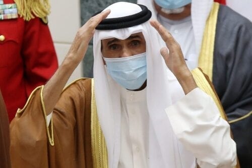 Sheikh Nawaf al-Ahmad Al-Sabah salutes the crowd after being sworn in as Kuwait's new Emir at the National Assembly in Kuwait City on September 30, 2020 [YASSER AL-ZAYYAT/AFP via Getty Images]