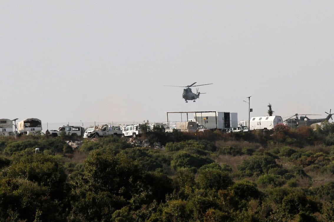 A Lebanese army helicopter hovers over the southern Lebanese border town of Naqura where the second round of of talks started on 28 October 2020 between Lebanon and Israel at a UN base on the demarcation of the maritime frontier between the two countries. [MAHMOUD ZAYYAT/AFP via Getty Images]
