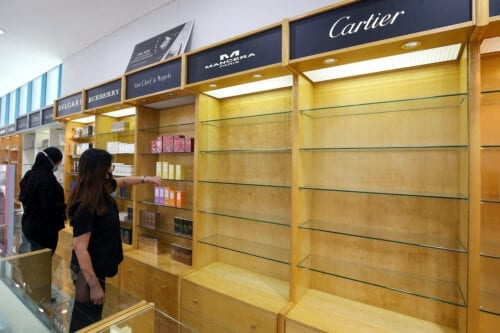 A picture shows an empty French cosmetics and perfume stand in Kuwait City on 28 October 2020, as part of a boycott in protest of cartoons depicting Islam's Prophet Mohamed published in the French media. [YASSER AL-ZAYYAT/AFP via Getty Images]