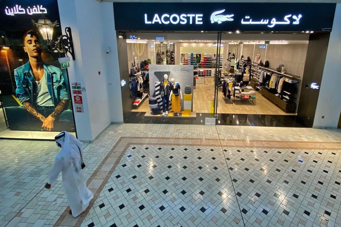 A shopper walks past the French store Lacoste at Villagio Mall in Qatar's capital Doha on 28 October 2020. [AFP via Getty Images]