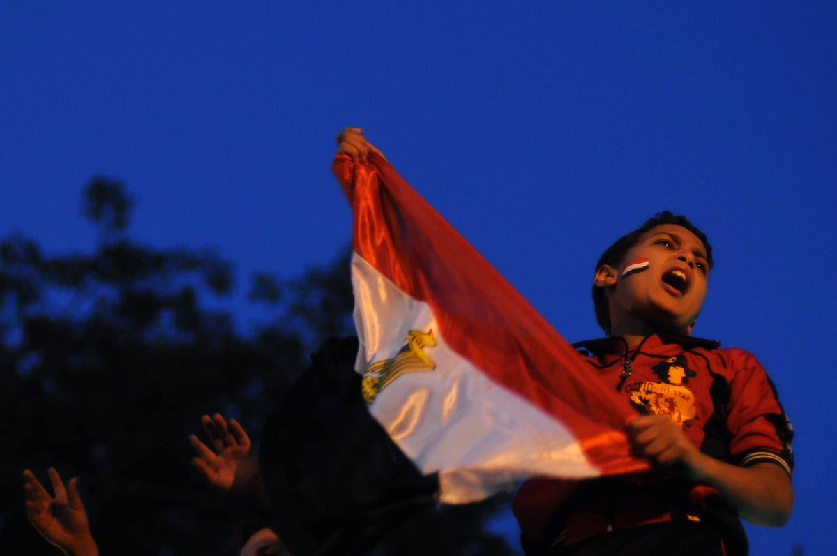 A young Egyptian protester waves his national flag and shouts slogans in Cairo's Tahrir Square on July 13, 2011 as hundreds continue to camp out in the square -- the epicentre of protests that toppled president Hosni Mubarak -- denouncing the army's handling of the transition from the former autocratic regime. AFP PHOTO/MOHAMED HOSSAM (Photo credit should read MOHAMED HOSSAM/AFP via Getty Images)
