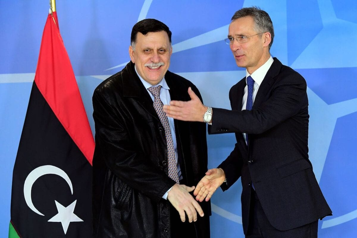 Why do Libyan politicians refrain from criticising NATO's war on their country, despite civilian deaths?