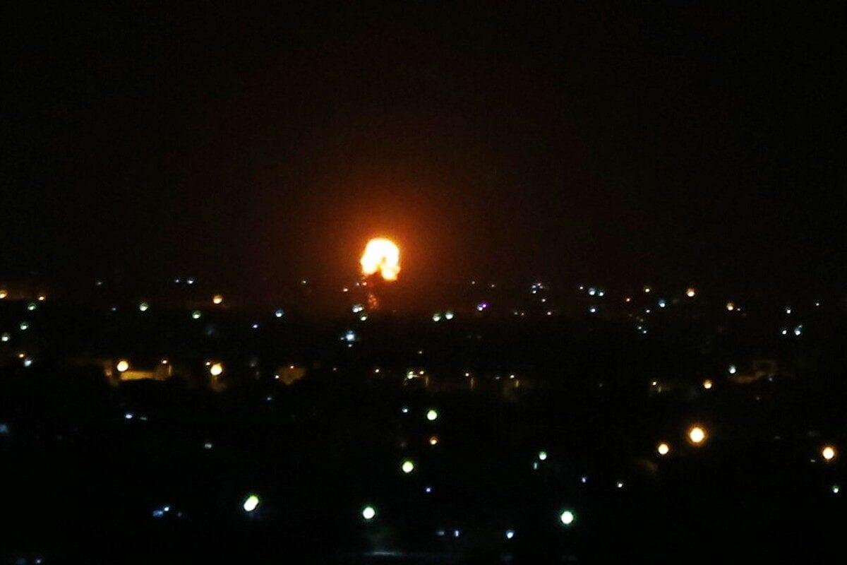 Explosion illuminates the night sky after Israeli warplanes hit farming areas in east of Deir al-Balah, Gaza on October 20, 2020 [Ashraf Amra/Anadolu Agency]