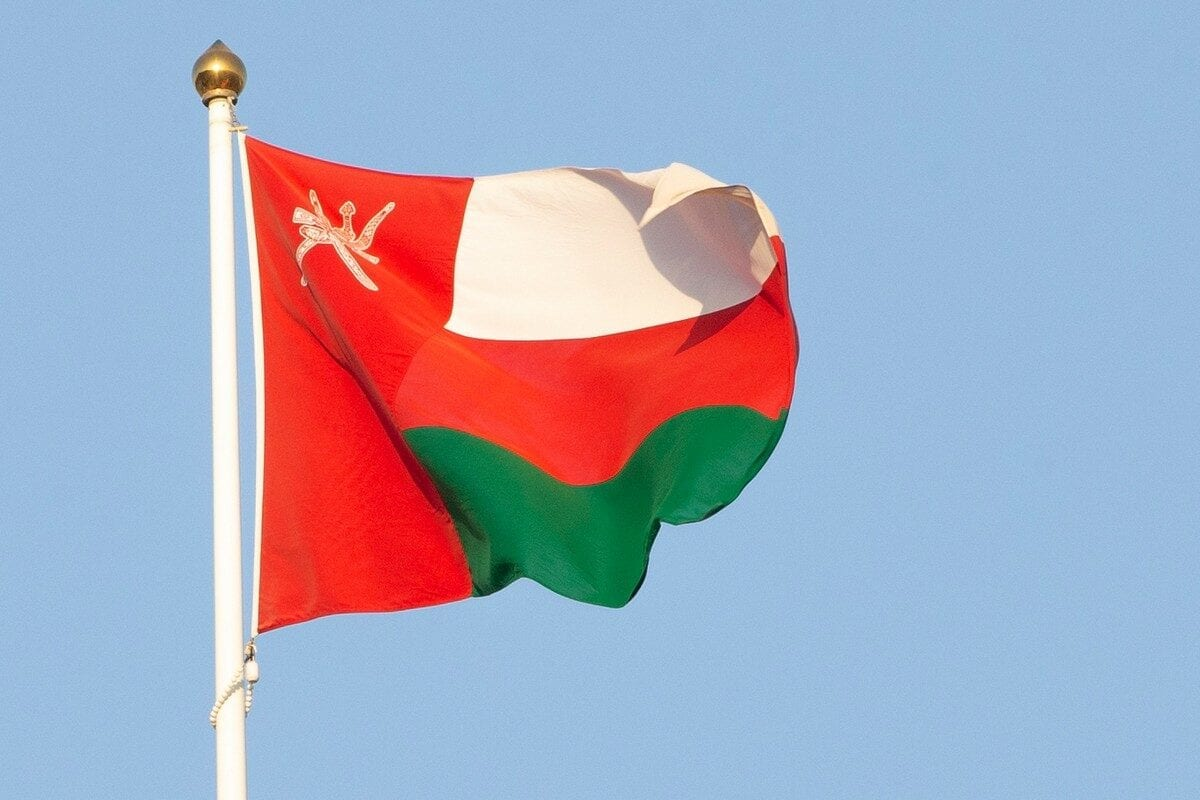 The Omani national flag waving in the wind in the capital Muscat on 18 September 2020 [HAITHAM AL-SHUKAIRI/AFP/Getty Images]
