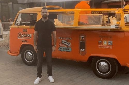 Issa Haj Yasin in front of his Hotdog Van in Ramallah, Palestine [Instagram]