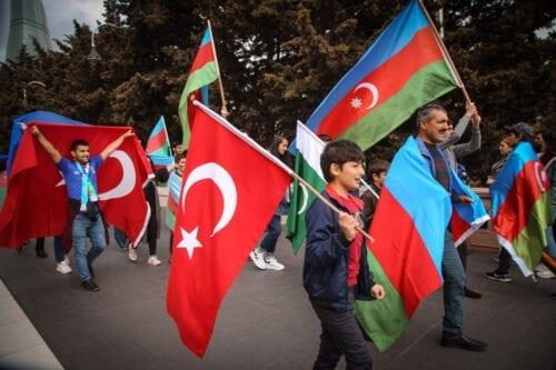 Azerbaijani and Turkey supporters celebrate the deal reached to halt fighting over the Nagorno-Karabakh region on 10 November 2020 [Resul Rehimov/Anadolu Agency]