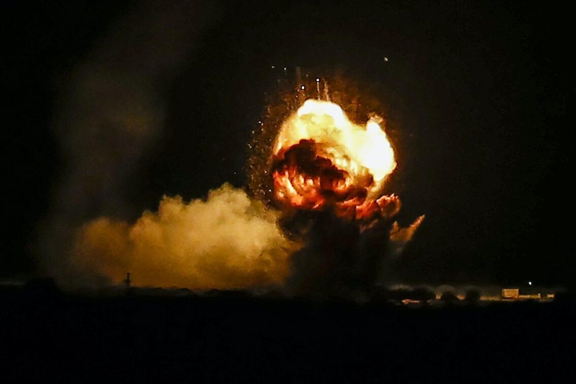 Flames and smoke are seen after an Israeli air strike hit Hamas targets in Khan Yunis, Gaza on 22 November 2020. [Abed Rahim Khatib - Anadolu Agency]