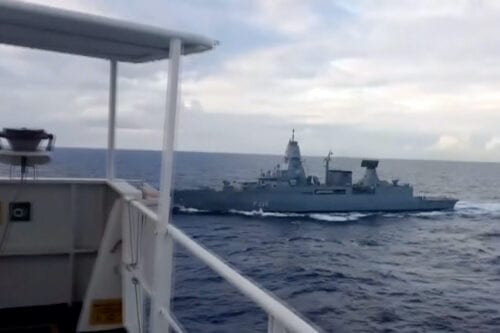 "AT SEA - NOVEMBER 23: (----EDITORIAL USE ONLY – MANDATORY CREDIT - ""MINISTRY OF NATIONAL DEFENCE OF TURKEY / HANDOUT"" - NO MARKETING NO ADVERTISING CAMPAIGNS - DISTRIBUTED AS A SERVICE TO CLIENTS----) A screen grab captured from a video shows a German frigate serving under a Greek-commanded EU naval mission conducted an hours-long and illegal search on a Turkish cargo ship carrying humanitarian supplies in the Eastern Mediterranean Sea to war-torn Libya, on November 23, 2020. The search reportedly violated international law, which requires a party to obtain the consent of a ship's flag state before searching a vessel, according to the law of the sea. ( TUR National Defence Ministry - Anadolu Agency )"