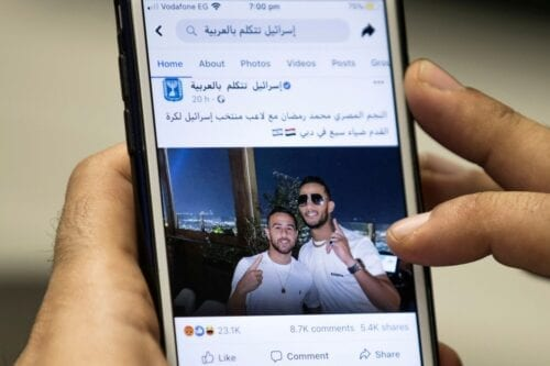 Egyptian actor and singer Mohamed Ramadan (R) posted by the official Facebook page of the State of Israel in Arabic hugging Israeli midfielder Dia Saba in Dubai [KHALED DESOUKI/AFP/Getty Images]