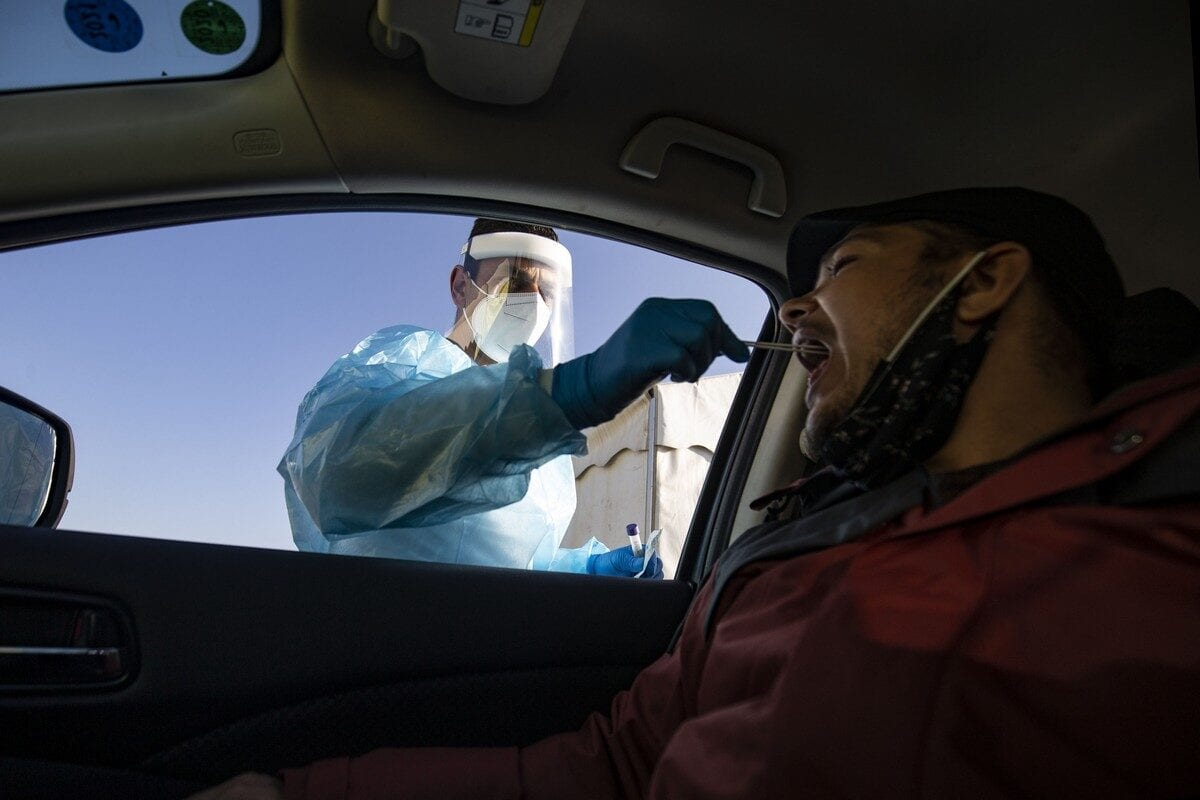 A drive through coronavirus test centre Health personnel in Jerusalem on 29 November 2020 [Mostafa Alkharouf/Anadolu Agency]